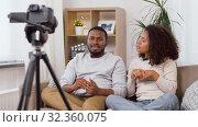 Купить «couple of video bloggers with camera at home», видеоролик № 32360075, снято 17 октября 2019 г. (c) Syda Productions / Фотобанк Лори