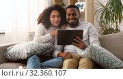 Купить «couple having video call on tablet pc at home», видеоролик № 32360107, снято 17 октября 2019 г. (c) Syda Productions / Фотобанк Лори
