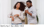 Купить «happy african american couple dancing at home», видеоролик № 32360143, снято 17 октября 2019 г. (c) Syda Productions / Фотобанк Лори