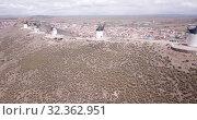 Купить «Aerial view of Wind mills at knolls at Consuegra, Toledo region, Spain», видеоролик № 32362951, снято 23 апреля 2019 г. (c) Яков Филимонов / Фотобанк Лори