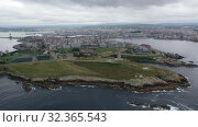 Купить «Aerial view of coast with lighthouse and center of A Coruna city, Spain», видеоролик № 32365543, снято 19 июня 2019 г. (c) Яков Филимонов / Фотобанк Лори