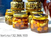 Купить «Goodbee Products. Glass jars: honey with seeds, cream honey with nuts at the gastronomic festival in Samara.», фото № 32366103, снято 27 июля 2019 г. (c) Акиньшин Владимир / Фотобанк Лори