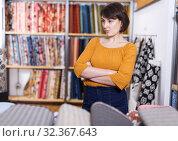 Купить «Displeased woman in fabric shop», фото № 32367643, снято 7 февраля 2019 г. (c) Яков Филимонов / Фотобанк Лори