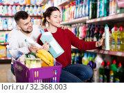 Купить «People buying detergents for house», фото № 32368003, снято 14 марта 2017 г. (c) Яков Филимонов / Фотобанк Лори