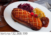 Купить «Fried duck breast Magre served with pickled cabbage, caramelized onions and jam», фото № 32368199, снято 17 ноября 2019 г. (c) Яков Филимонов / Фотобанк Лори