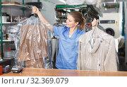 Купить «Young woman worker of laundry», фото № 32369079, снято 9 мая 2018 г. (c) Яков Филимонов / Фотобанк Лори
