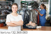 Купить «Happy woman at dry cleaning», фото № 32369083, снято 9 мая 2018 г. (c) Яков Филимонов / Фотобанк Лори