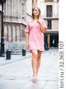 Купить «Woman strolling at old town streets», фото № 32369107, снято 5 декабря 2019 г. (c) Яков Филимонов / Фотобанк Лори