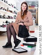 Купить «Young smiling female is choosing sport shoes in shoes shop.», фото № 32382995, снято 13 декабря 2017 г. (c) Яков Филимонов / Фотобанк Лори