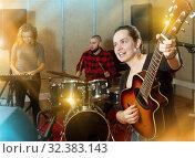 Купить «Smiling guitar player and singer with band», фото № 32383143, снято 26 октября 2018 г. (c) Яков Филимонов / Фотобанк Лори
