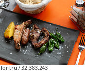 Pork barbeque ribs and sausages with peppers and potato. Стоковое фото, фотограф Яков Филимонов / Фотобанк Лори