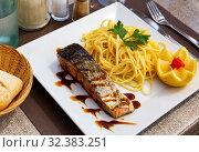Купить «Roasted salmon and pasta», фото № 32383251, снято 17 ноября 2019 г. (c) Яков Филимонов / Фотобанк Лори