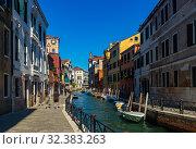 Купить «Venice with colorful buildings and canals, popular destination of Italy», фото № 32383263, снято 5 сентября 2019 г. (c) Яков Филимонов / Фотобанк Лори
