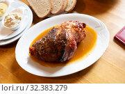 Купить «Fried pork knuckle (boar knee) with mustard and horseradish. Traditional czech dish», фото № 32383279, снято 21 ноября 2019 г. (c) Яков Филимонов / Фотобанк Лори