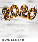 Купить «Happy New year 2020 celebration. Bright gold balloons figures, New Year Balloons with glitter stars on wood white background. Christmas and new year celebration. Gold foil balloons 2020», фото № 32385635, снято 2 ноября 2019 г. (c) Сергей Тимофеев / Фотобанк Лори