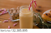 Купить «glass mug of eggnog, ingredients and sweets», видеоролик № 32385895, снято 2 ноября 2019 г. (c) Syda Productions / Фотобанк Лори