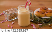 Купить «glass mug of eggnog, ingredients and sweets», видеоролик № 32385927, снято 2 ноября 2019 г. (c) Syda Productions / Фотобанк Лори