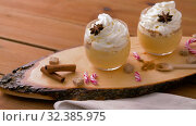 Купить «eggnog with whipped cream and spices on wood», видеоролик № 32385975, снято 2 ноября 2019 г. (c) Syda Productions / Фотобанк Лори