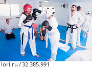 Females 21-31 years old are sparring in pair to use taekwondo technique. Стоковое фото, фотограф Яков Филимонов / Фотобанк Лори