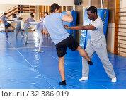 Two men practicing self defense techniques. Стоковое фото, фотограф Яков Филимонов / Фотобанк Лори
