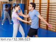 Купить «People practicing self defense techniques», фото № 32386023, снято 31 октября 2018 г. (c) Яков Филимонов / Фотобанк Лори