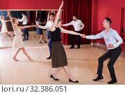 Купить «People practicing vigorous lindy hop movements», фото № 32386051, снято 24 мая 2017 г. (c) Яков Филимонов / Фотобанк Лори