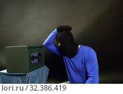 Купить «The thief breaks the safe with a combination lock», фото № 32386419, снято 12 апреля 2015 г. (c) Арестов Андрей Павлович / Фотобанк Лори