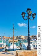 Купить «Port and seafront in Aegina town», фото № 32388571, снято 12 сентября 2019 г. (c) Роман Сигаев / Фотобанк Лори