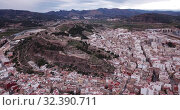Купить «Aerial view of Sagunto city and antique roman fortress, Valencia, Spain», видеоролик № 32390711, снято 19 марта 2019 г. (c) Яков Филимонов / Фотобанк Лори