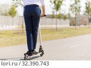 Купить «young businessman riding electric scooter outdoors», фото № 32390743, снято 1 августа 2019 г. (c) Syda Productions / Фотобанк Лори