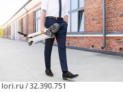 Купить «businessman with folding scooter on rooftop», фото № 32390751, снято 1 августа 2019 г. (c) Syda Productions / Фотобанк Лори