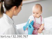 doctor making vaccine for baby patient at clinic. Стоковое фото, фотограф Syda Productions / Фотобанк Лори
