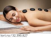 Купить «woman having hot stone massage at spa», фото № 32390827, снято 13 октября 2019 г. (c) Syda Productions / Фотобанк Лори