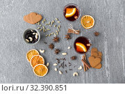 Купить «hot mulled wine, orange slices, raisins and spices», фото № 32390851, снято 4 октября 2018 г. (c) Syda Productions / Фотобанк Лори