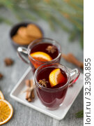 Купить «mulled wine, orange slices, gingerbread and spices», фото № 32390855, снято 4 октября 2018 г. (c) Syda Productions / Фотобанк Лори