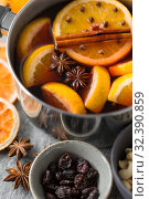 Купить «pot with hot mulled wine, orange slices and spices», фото № 32390859, снято 4 октября 2018 г. (c) Syda Productions / Фотобанк Лори