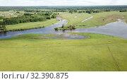 Купить «Panoramic view of gulf meadows in the floodplain of the Oka River, Russia», видеоролик № 32390875, снято 27 июня 2018 г. (c) Яков Филимонов / Фотобанк Лори