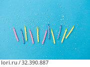 Купить «birthday candles with sprinkles on blue background», фото № 32390887, снято 12 декабря 2018 г. (c) Syda Productions / Фотобанк Лори