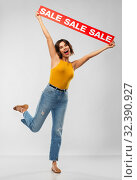 Купить «happy smiling young woman posing with sale banner», фото № 32390927, снято 30 сентября 2019 г. (c) Syda Productions / Фотобанк Лори