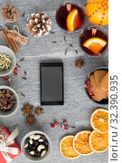 Купить «smartphone, hot mulled wine and christmas spices», фото № 32390935, снято 4 октября 2018 г. (c) Syda Productions / Фотобанк Лори
