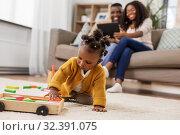 Купить «african baby girl playing with toy blocks at home», фото № 32391075, снято 29 сентября 2019 г. (c) Syda Productions / Фотобанк Лори