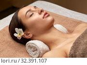 Купить «young woman lying at spa or massage parlor», фото № 32391107, снято 13 октября 2019 г. (c) Syda Productions / Фотобанк Лори