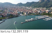 Купить «Picturesque view of city of Como on shore of Lake Como on background of mountain at sunny morning, Italy», видеоролик № 32391119, снято 1 сентября 2019 г. (c) Яков Филимонов / Фотобанк Лори
