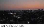 Купить «Night Sihanoukville city in Cambodia drone shot 4K», видеоролик № 32391515, снято 26 октября 2019 г. (c) Aleksejs Bergmanis / Фотобанк Лори