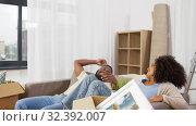 Купить «happy couple with boxes moving to new home», видеоролик № 32392007, снято 3 ноября 2019 г. (c) Syda Productions / Фотобанк Лори