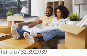 Купить «couple with boxes and blueprint moving to new home», видеоролик № 32392039, снято 3 ноября 2019 г. (c) Syda Productions / Фотобанк Лори