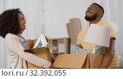 Купить «happy couple moving to new home and dancing», видеоролик № 32392055, снято 3 ноября 2019 г. (c) Syda Productions / Фотобанк Лори