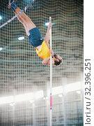 Купить «Pole vaulting - a athletic man jumping over the bar - leaning on the pole», фото № 32396251, снято 1 ноября 2019 г. (c) Константин Шишкин / Фотобанк Лори