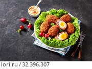 Купить «traditional fried scotch eggs on a plate», фото № 32396307, снято 4 сентября 2019 г. (c) Oksana Zh / Фотобанк Лори