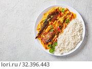 Купить «Panang curry with Grilled Saba fish on white plate», фото № 32396443, снято 11 сентября 2019 г. (c) Oksana Zh / Фотобанк Лори